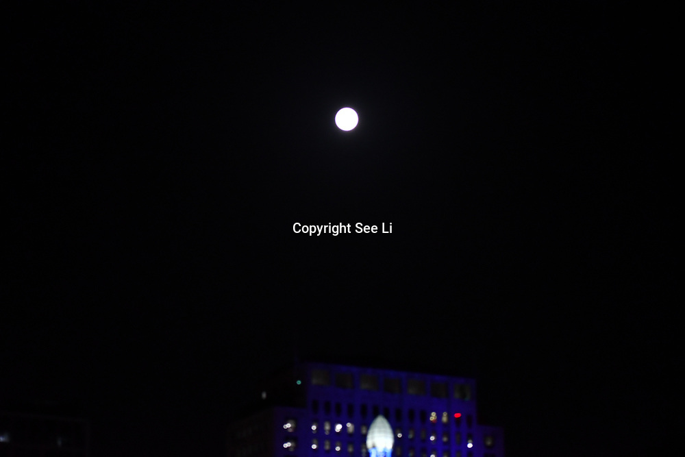 Chinese Mid-Autumn Festival full moon at Embankment Bridige on 13th September 2019, London, UK.