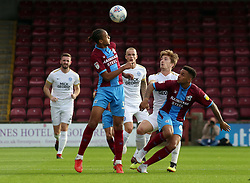 Alex Woodyard of Peterborough United keeps his eye on the ball with Cameron Borthwick-Jackson of Scunthorpe United - Mandatory by-line: Joe Dent/JMP - 13/10/2018 - FOOTBALL - Glanford Park - Scunthorpe, England - Scunthorpe United v Peterborough United - Sky Bet League One