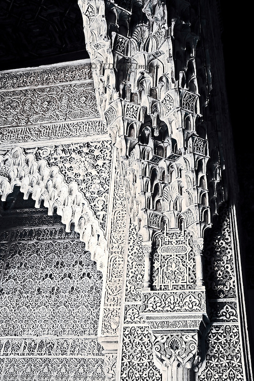 Detail of the elaborate stalagtite carved marble ornament in the walls and arcades of the Plaza of Myrtles, Alhambra.