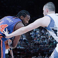 06 October 2010: New York Knicks center Ronny Turiaf #14 vies with Minnesota Timberwolves forward Kevin Love during the Minnesota Timberwolves 106-100 victory over the New York Knicks, during 2010 NBA Europe Live, at the POPB Arena in Paris, France.