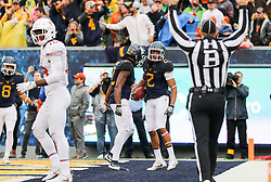 Nov 18, 2017; Morgantown, WV, USA; West Virginia Mountaineers wide receiver Ka'Raun White (2) celebrates after catching a touchdown pass during the fourth quarter against the Texas Longhorns at Milan Puskar Stadium. Mandatory Credit: Ben Queen-USA TODAY Sports
