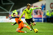 Dundee United midfielder Tony Andreu (#19) slides in on Hibernian midfielder Andrew Shinnie (#22) during the Ladbrokes Scottish Championship match between Dundee United and Hibernian at Tannadice Park, Dundee, Scotland on 10 March 2017. Photo by Craig Doyle.
