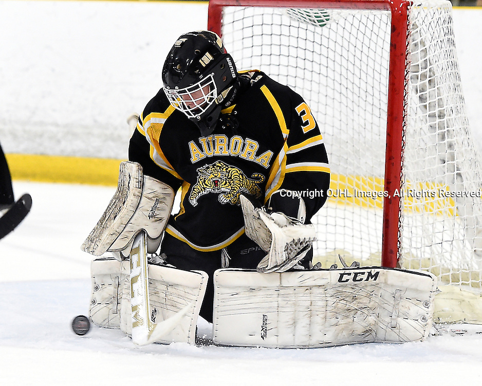 TORONTO, ON - Apr 13 : Ontario Junior Hockey League, Buckland Cup Championship Series between the Aurora Tigers and the Toronto Lakeshore Patriots, Kevin Entmaa #37 of the Aurora Tigers makes the save during first period game action.<br /> (Photo by Andy Corneau / OJHL Images)