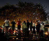 Friends of 14-year-old Danny Oates hold a candlelight vigil in Le Bard Park in Huntington Beach Thursday night..