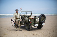 Reenactors with an original Willy's jeep on Omaha Beach