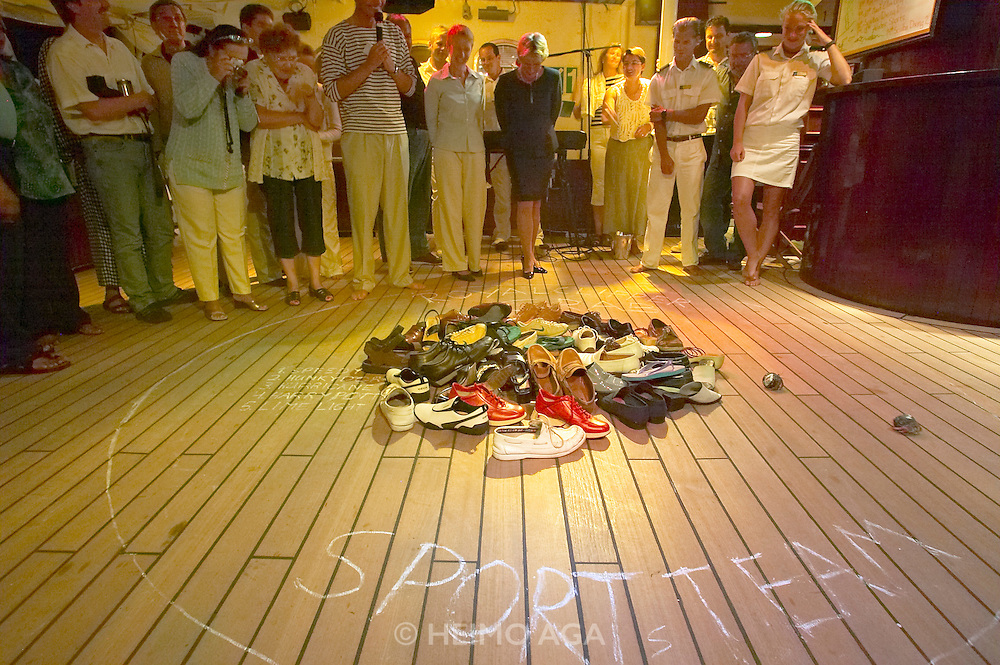 The Crab Race aboard the Royal Clipper. Benefits go to the Sports Team. The last round is made more difficult with the help of passengers' shoes.