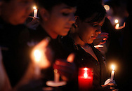 A student cries during a candlelight vigil for Lt. Cmdr. Rick Mead at Ray High School in Corpus Christi. Members of the Ray High School community came together for the vigil after the long-time JROTC commander died suddenly over the weekend.