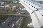 From the window seat of an Airbus A319, the M25 motorway below just outside Heathrow airport, on 26th March 2017, at London, England.