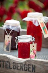 Tray of homemade raspberry and blackberry jams