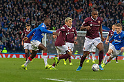 Uche Ikpeazu of Hearts looks for a route to goal during the Betfred Scottish League Cup semi-final match between Rangers and Heart of Midlothian at Hampden Park, Glasgow, United Kingdom on 3 November 2019.