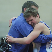 Middletown Brian Schneider celebrates with a coach after defeating Hodgson Joey Conner in a 138 pound bout during the Blue Hen Conference Wrestling Tournament Finals Saturday, Feb. 20, 2016 at William Penn High School in New Castle.