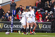 England players celebrate the opening try of the first half during the Women's 6 Nations match between England Women and France Women at the Keepmoat Stadium, Doncaster, England on 10 February 2019.