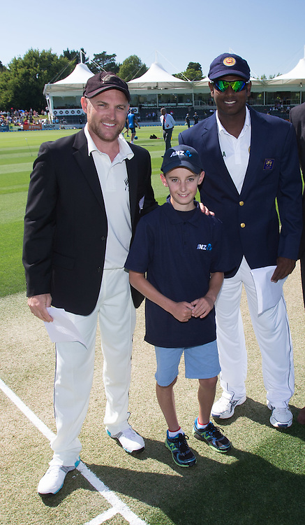 ANZ coin toss winner with Black Caps captain Brendon McCullum and Sri Lankan captain Angelo Mathews before the match. First day, ANZ Boxing Day Cricket Test, New Zealand Black Caps v Sri Lanka, 26 December 2014, Hagley Oval, Christchurch, New Zealand. Photo: John Cowpland / photosport.co.nz