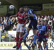 Nationwide Division 2 27-10-2001.Wycombe Wanderers FC v Swindon Town FC:.Captains contest. Neil (Razor) Rudduck and Pual MaCarthy contest the high ball.... ...........