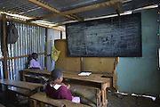 Just outside downtown Nairobi, Kenya is the The Lenana Slum and the KevJumba school built by the NGO The Supply, images from a photography workshop in january 2014. Photo©SuziAltman In 2014, Suzi Altman traveled to Kenya at the invitation of The Supply, an NGO that operates a school in the Lenana slum, near Nairobi.<br />