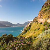 View of Chapman's Peak drive with Hout Bay in the distance, near Cape Town, South Africa.