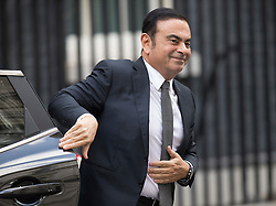 © Licensed to London News Pictures. 14/10/2016. London, UK. Nissan Chairman and CEO Carlos Ghosn arrives in Downing for talks with Prime Minister Theresa May. Mr Ghosn ha stated that he would like a government pledge to  compensate Nissan for any tariffs that may be imposed after the UK leaves the EU. Photo credit: Peter Macdiarmid/LNP