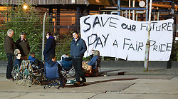 "© licensed to London News Pictures . 27/07/2012 . Manchester , UK . Protesters sit in front of a banner that reads "" Save our future pay a fair price "" . Protesting farmers blockade Robert Wiseman Dairies in Trafford Park , Manchester . Protesters said Robert Wiseman had not increased the price they paid for their milk and were intending to reduce the price in August . A worker at Robert Wiseman reported that 99 milk delivery lorries were prevented from leaving the depot by the blockade . Photo credit : Joel Goodman/LNP"