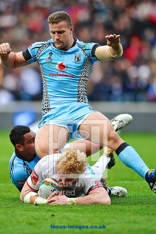 Picture by Ian Wadkins/Focus Images Ltd +44 7877 568959<br /> 09/11/2013<br /> James Graham of England is tackled during the Rugby League World Cup 2013 match at the KC Stadium, Kingston upon Hull.