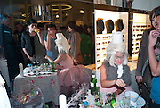 SERVING COKTAILS AND CAKES, , Wolf & Badger - pop-up store launch party. Wonder Room, Selfridges, 13 August 2010. -DO NOT ARCHIVE-© Copyright Photograph by Dafydd Jones. 248 Clapham Rd. London SW9 0PZ. Tel 0207 820 0771. www.dafjones.com.