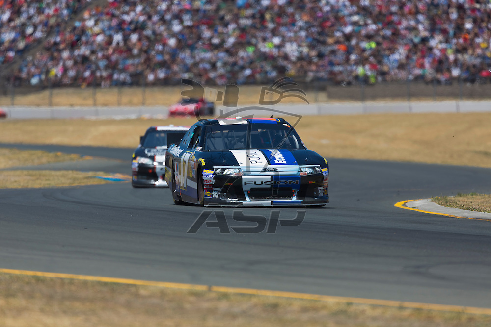 SONOMA, CA - JUN 24, 2012:  Matt Kenseth (17) brings his car through the turns during the Toyota Save Mart 350 at the Raceway at Sonoma in Sonoma, CA.