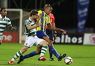 Sporting's midfielder Adrien (L )  vies with União da Madeira midfielder Cadiz  (R ) during Portuguese first league football match União vs Sporting held at Madeira stadium in Funchal on December 20, 2015.  LUSA / GREGORIO CUNHA