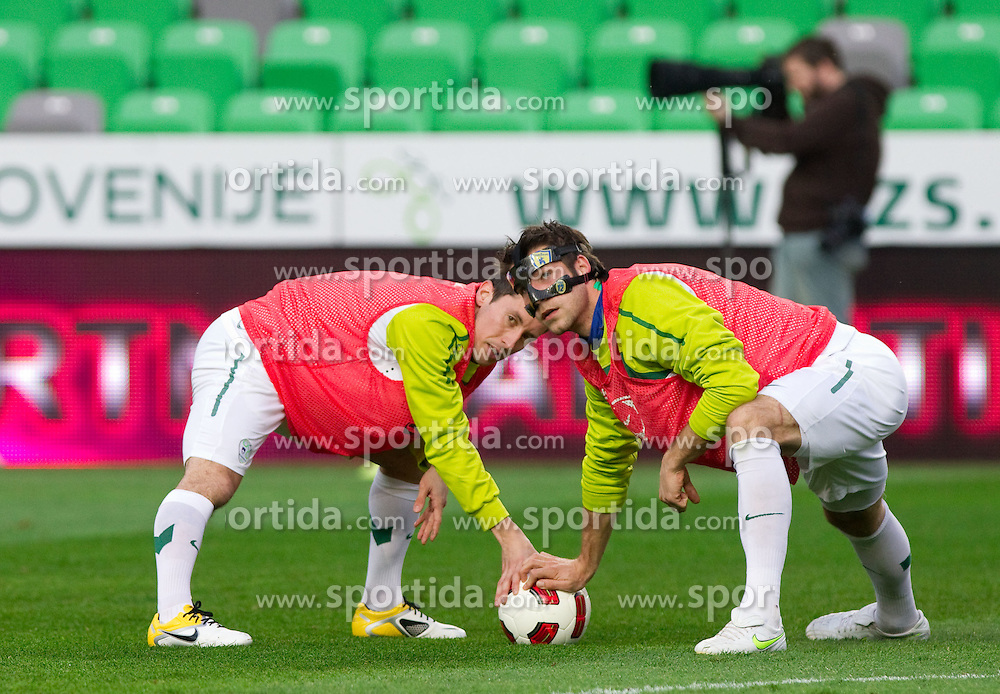 Robert Koren and Bostjan Cesar during practice session of National team of Slovenia 1 day before EURO 2012 Qualifications match against Italy, on March 24, 2011, SRC Stozice, Ljubljana, Slovenia. (Photo by Vid Ponikvar / Sportida)