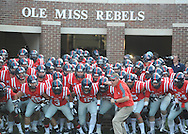 Mississippi Coach Hugh Freeze leads the team onto the field vs. Southeast Missouri State at Vaught-Hemingway Stadium in Oxford, Miss. on Saturday, September 7, 2013. (AP Photo/Oxford Eagle, Bruce Newman)