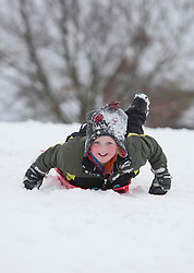 © Licensed to Alison Baskerville. 24/03/2013. Warwickshire, UK.  Eden, 8 from Kenilworth enjoys the return of the snow today in Abbey Fields park.  The wintery weather comes just over a week before the start of British Summer Time.  Photo credit: Alison Baskerville/LNP
