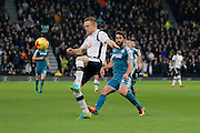 Derby County defender Alex Pearce (16) clears the ball from Wigan Athletic striker Will Grigg (9) during the EFL Sky Bet Championship match between Derby County and Wigan Athletic at the iPro Stadium, Derby, England on 31 December 2016. Photo by Richard Holmes.