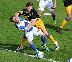 Mansfield Town's Martin Riley fouls Bristol Rovers' Chris Beardsley - Photo mandatory by-line: Alex James/JMP - Mobile: 07966 386802 03/05/2014 - SPORT - FOOTBALL - Bristol - Memorial Stadium - Bristol Rovers v Mansfield - Sky Bet League Two