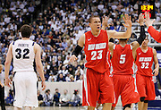 New Mexico guard Phillip McDonald (23) celebrates as BYU guard Jimmer Fredette (32) walks away during the second half of an NCAA college basketball game in Provo, Utah, Wednesday, March. 2, 2011. McDonald scored 26 points in New Mexico's 82-64 win over third-ranked BYU. (AP Photo/Colin E Braley)