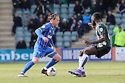 Dannie Bulman midfielder of AFC Wimbledon (4) during the Sky Bet League 2 match between Plymouth Argyle and AFC Wimbledon at Home Park, Plymouth, England on 9 April 2016. Photo by Stuart Butcher.