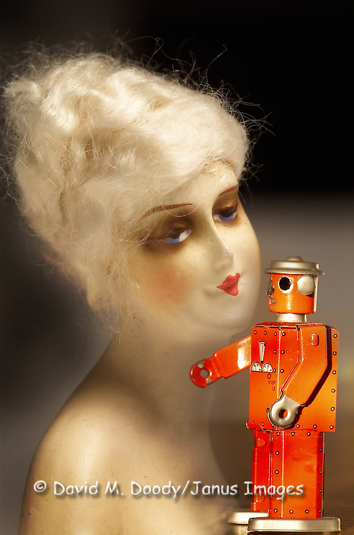 """""""Mechanical Love"""" Composite image of Victorian doll and 1950s toy robot."""