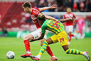 Middlesbrough midfielder Paddy McNair (17) and West Bromwich Albion midfielder Grady Diangana (29) battle for the ball during the EFL Sky Bet Championship match between Middlesbrough and West Bromwich Albion at the Riverside Stadium, Middlesbrough, England on 19 October 2019.