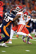 Denver Broncos rookie running back Royce Freeman (28) is tackled by leaping Kansas City Chiefs cornerback Kendall Fuller (23) as Freeman runs for a first quarter gain of 11 yards and a first down at the Broncos 31 yard line during the NFL week 4 regular season football game against the Kansas City Chiefs on Monday, Oct. 1, 2018 in Denver. The Chiefs won the game 27-23. (©Paul Anthony Spinelli)