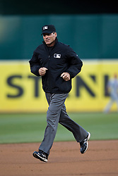 OAKLAND, CA - APRIL 29:  MLB umpire Angel Hernandez #55 runs across the infield during the first inning between the Oakland Athletics and the Los Angeles Angels of Anaheim at O.co Coliseum on April 29, 2015 in Oakland, California. The Los Angeles Angels of Anaheim defeated the Oakland Athletics 6-3. (Photo by Jason O. Watson/Getty Images) *** Local Caption *** Angel Hernandez