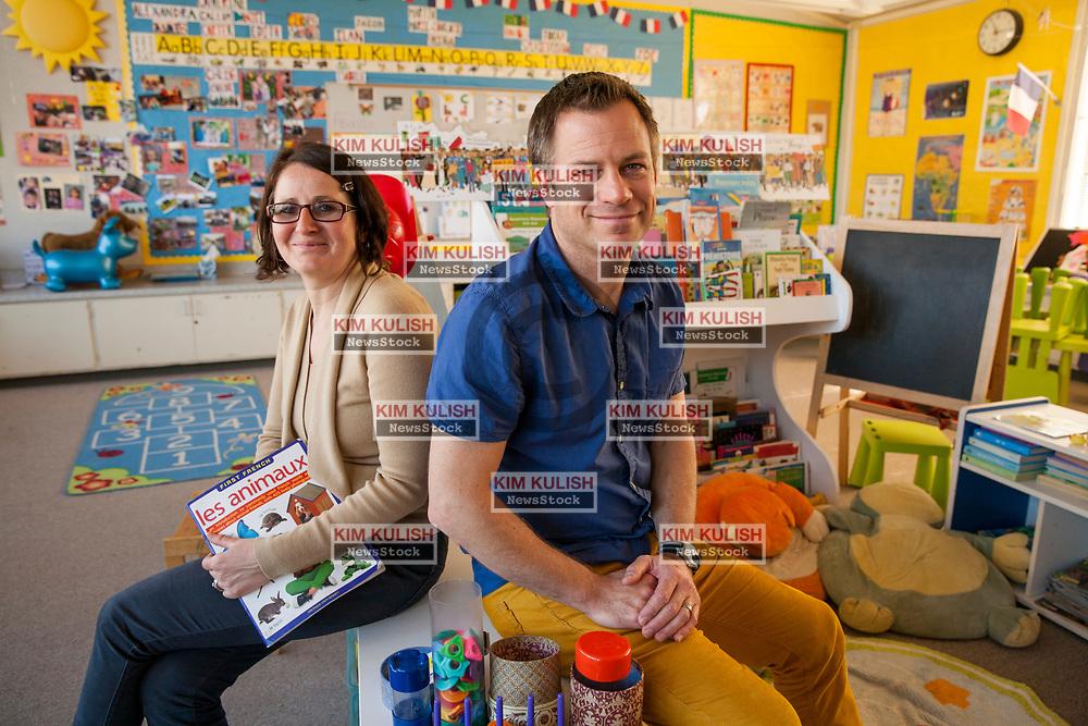 Portrait of Emmanuelle Benefield, director/teacher, left, and  Brian Benefield, teacher at Ma Petite École, in Santa Rosa, California.