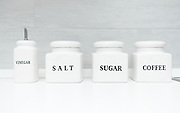 Vinegar, salt, sugar and coffee containers in kitchen