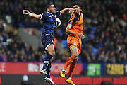 Bolton Wanderers midfielder Liam Feeney and Kevin Bru, Ipswich Town midfielder challenge for the cross in the box  during the Sky Bet Championship match between Bolton Wanderers and Ipswich Town at the Macron Stadium, Bolton, England on 8 March 2016. Photo by Simon Brady.