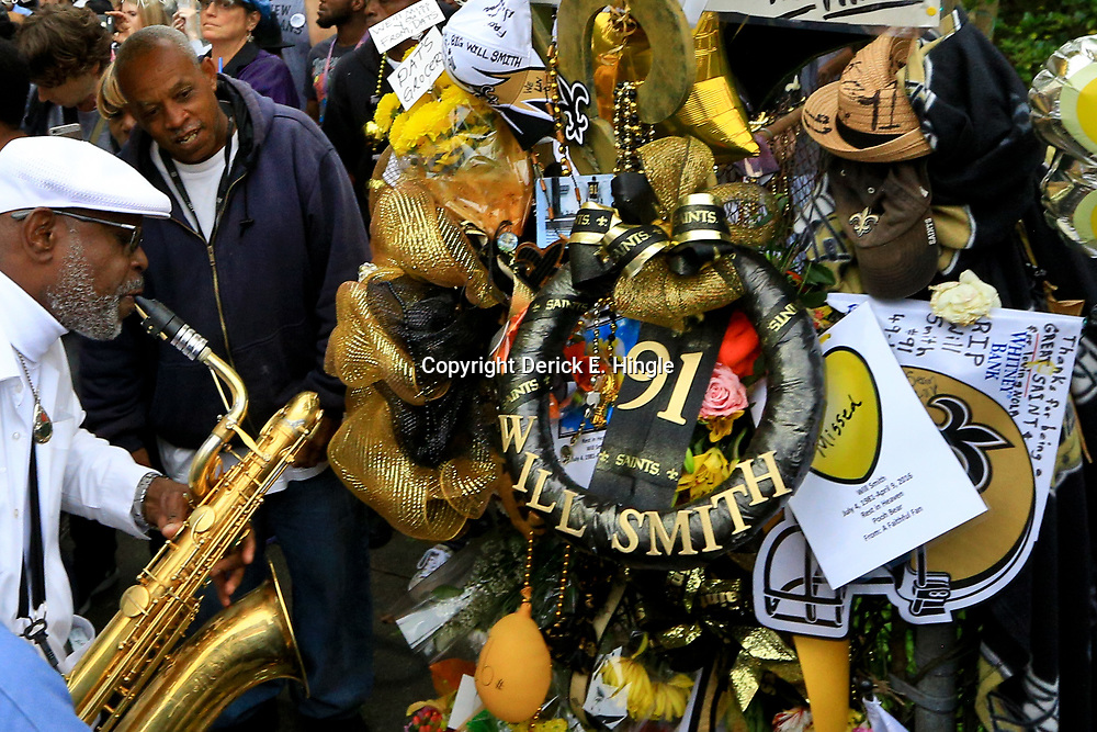 Apr 15, 2016; New Orleans, LA, USA; A man plays a saxophone during a second-line parade in tribute to the retired NFL athlete Will Smith at the a memorial at Sophie B. Wright Place and Felicity Street. Smith was shot and killed late Saturday night at the memorial location after being involved in a minor traffic accident. Mandatory Credit: Derick E. Hingle-USA TODAY Sports