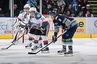 KELOWNA, CANADA - JANUARY 24: Jesse Lees #2 and Henrik Nyberg #21 of the Kelowna Rockets line up against Justin Hickman #9 of the Seattle Thunderbirds at the Kelowna Rockets on January 24, 2013 at Prospera Place in Kelowna, British Columbia, Canada (Photo by Marissa Baecker/Shoot the Breeze) *** Local Caption ***