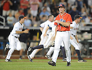 Mississippi's Aaron Greenwood (44) walks off the field as Virginia celebrates their win in the bottom of the 9th inning in the College World Series in Omaha, Neb. on Sunday, June 15, 2014. Virginia won 2-1.
