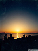 Silouhettes of people sitting on the beach at sunset, Ibiza, 2000
