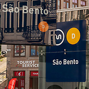Reflection of the exterior of the Sao Bento Train station in a shop window, Porto, Portugal