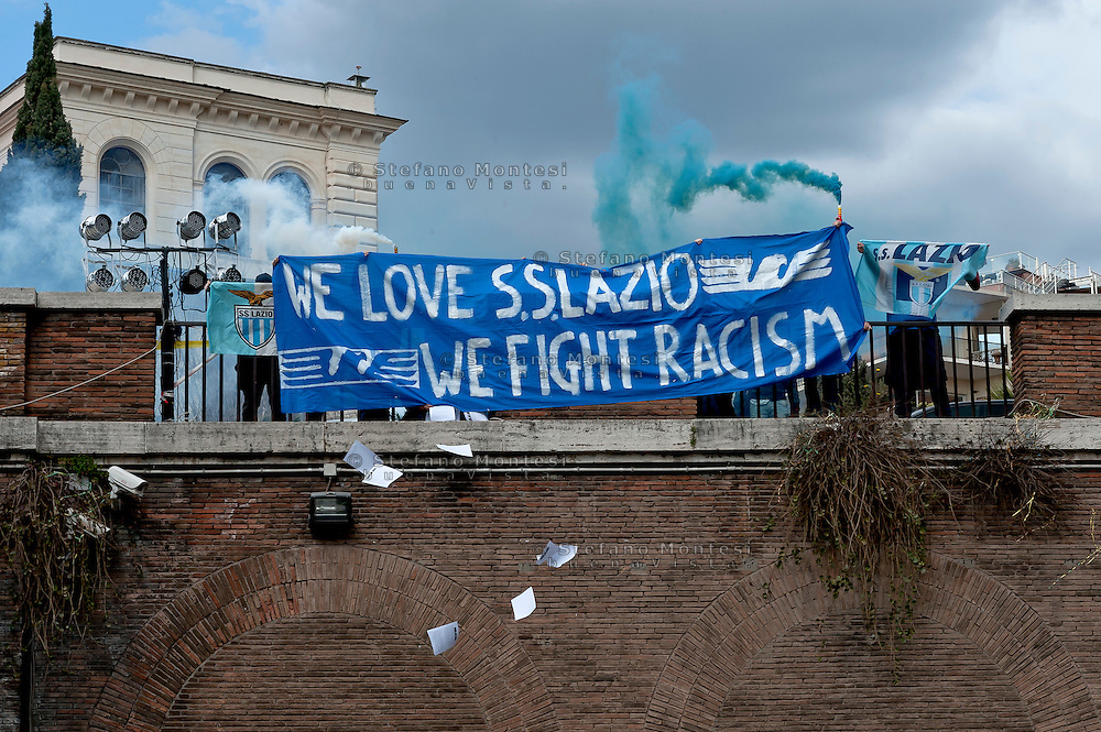 """""""We Love S.S. Lazio 1900 - We Fight Racism"""".<br /> A group of Lazio fans staged a flash mob at the Colosseum on Thursday to show that not all supporters of Rome's oldest soccer club are racist before the second leg of their last-16 Europa League tie against Sparta Prague. Lazio have been punished for racism by their fans on several occasions in the past and they risk fresh sanctions after visiting supporters subjected Sparta's full back Costa, who is black, to jeers when he touched the ball in the first leg in Prague last week. Rome, Italy 17th March 2016"""