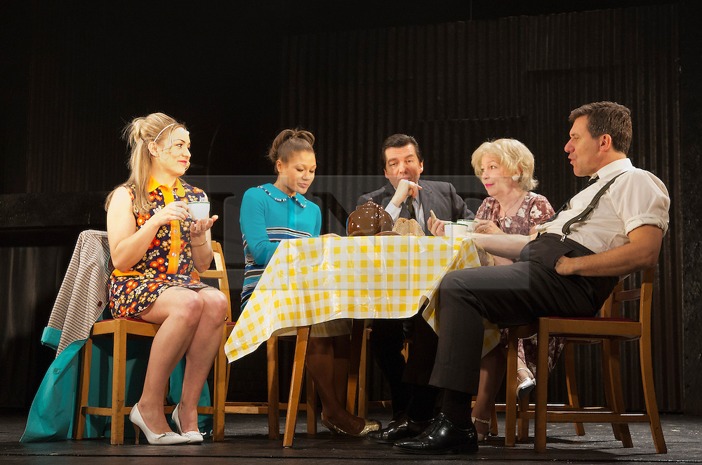 """© Licensed to London News Pictures. 23/10/2012. London, England. L-R: Claire-Louise Cordwell (Maura), Allyson Ava-Brown (Marge), James Clyde (Michael), Veronica Quilligan (Sarah) and Dale Rapley (Geoffrey). A new stage adaptation to celebrate the 20th anniversary of Martina Cole's first bestselling novel """"Dangerous Lady"""" opens at the Theatre Royal Stratford East. Directed by Lisa Goldman it will run to November 17th. The title role is played by Claire-Louse Cordwell (as Maura). Photo credit: Bettina Strenske/LNP"""