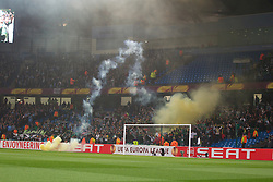 MANCHESTER, ENGLAND - Thursday, March 15, 2012: Sporting Clube de Portugal supporters set off flares during the UEFA Europa League Round of 16 2nd Leg match against Manchester City at City of Manchester Stadium. (Pic by Vegard Grott/Propaganda)