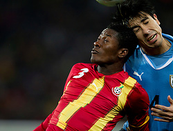 Asamoah Gyan of Ghana vs Jorge Fucile of Uruguay  during to the 2010 FIFA World Cup South Africa Quarter Finals football match between Uruguay and Ghana on July 02, 2010 at Soccer City Stadium in Sowetto, suburb of Johannesburg. (Photo by Vid Ponikvar / Sportida)