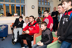 Richard O'Donnell of Bristol City plays FIFA with children during Bristol City's visit to the Children's Hospice South West at Charlton Farm - Mandatory by-line: Robbie Stephenson/JMP - 21/12/2016 - FOOTBALL - Children's Hospice South West - Bristol , England - Bristol City Children's Hospice Visit
